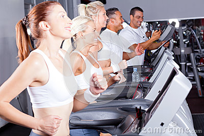 People exercising with treadmill