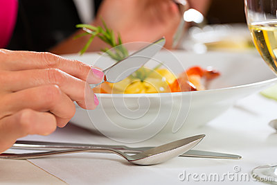 People fine dining in elegant restaurant