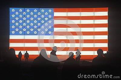 People in front of an American Flag