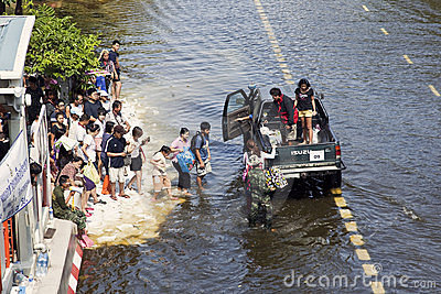 People get into a car on a flooded station Editorial Stock Image
