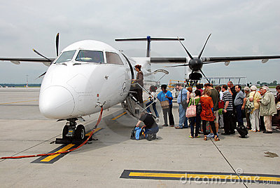 People getting on the plane Editorial Photo
