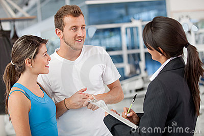 People with the gym manager