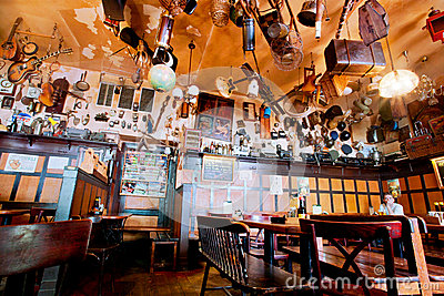 People have dinner inside the cozy restaurant Editorial Stock Image