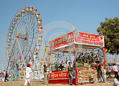 People are having fun at amusement park during traditional camel mela in Pushkar Editorial Photo