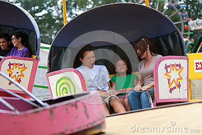 People Having Fun On Ride At County Fair Editorial Photo
