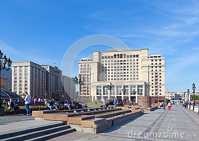 People having a rest on benches on Manezh Square in Moscow