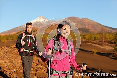 People hiking - healthy active lifestyle couple