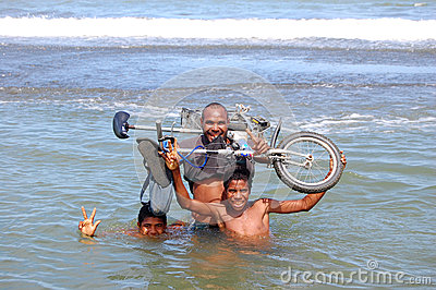 People with holding bycicle at river Editorial Photography