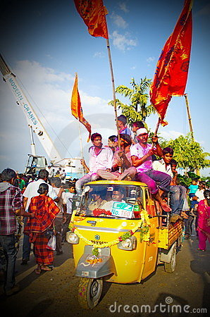 people holding flags on the dayof Ganesh Nimajjan Editorial Stock Photo