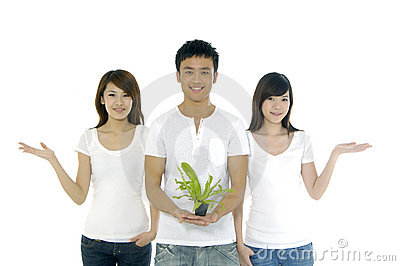 People on holding a small plant
