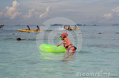 People kayaking and snorkeling in Andaman Sea Editorial Image