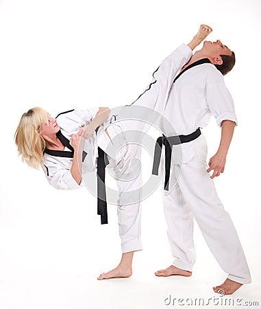 People in kimono fight on white