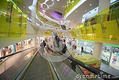 People in large supermarket Ashan Troyka Editorial Stock Image