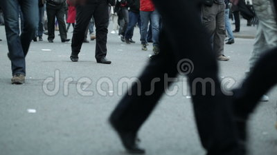People legs walking in city. Shot on Canon 5D Mark II with Prime L Lenses