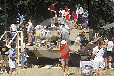 People Looking at Military Tank Editorial Photo