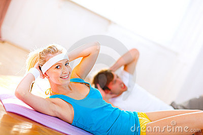 People making abdominal crunch in gym