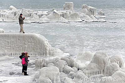 People making photos near frozen sea coastline Editorial Stock Photo