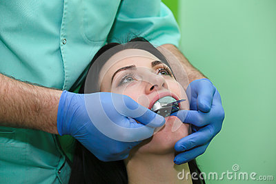People, medicine, stomatology and health care concept - close up of dentists and assistant with mirror Stock Photo