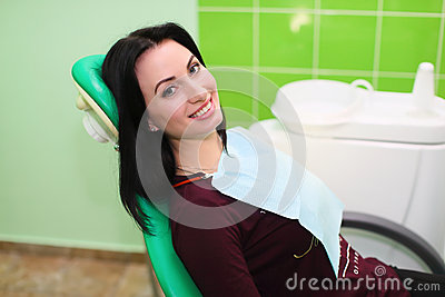 People, medicine, stomatology and health care concept - happy patient girl showing thumbs up at dental clinic office Stock Photo
