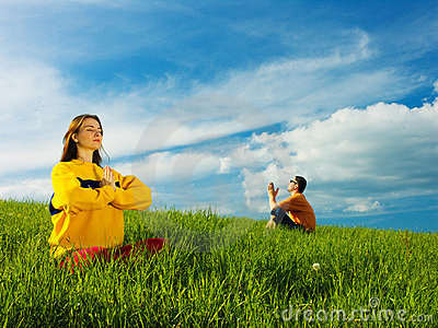 People Meditating in Field