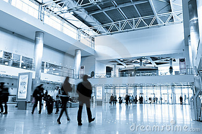 People in modern business centre hall