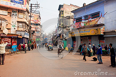 People movement with the cycles on the busy indian street with the old buildings