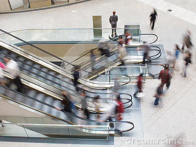 People moving on an Escalator