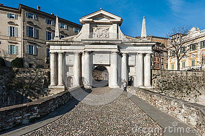 People near city gates of San Marco in Bergamo town, Italy. Editorial Image