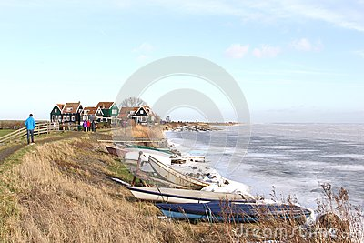 People near the village Marken along a frozen Markermeer in the Netherlands Editorial Stock Photo
