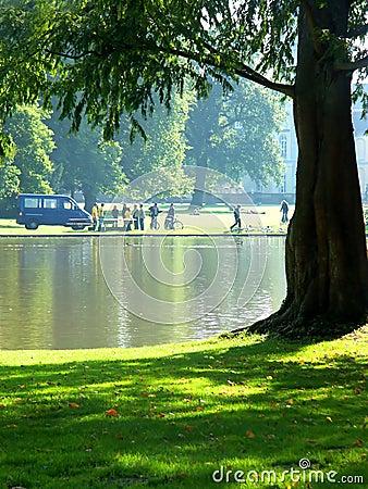 People next to a lake