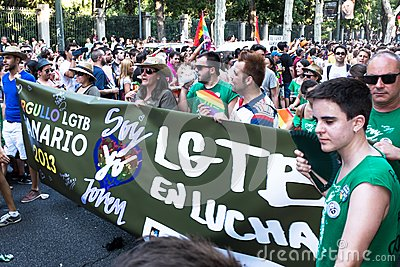 People participating on a demonstration at the Gay Pride parade in Madrid Editorial Photography