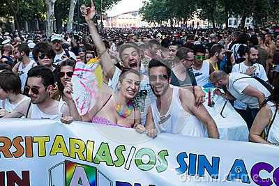 People participating on a demonstration at the Gay Pride parade in Madrid Editorial Stock Photo
