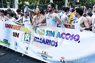 People participating on a demonstration at the Gay Pride parade in Madrid Editorial Photo