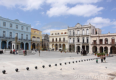 People passing by in plaza vieja, havana Editorial Stock Image