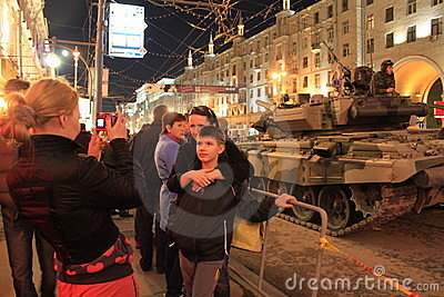 People are photographed against tanks Editorial Stock Image