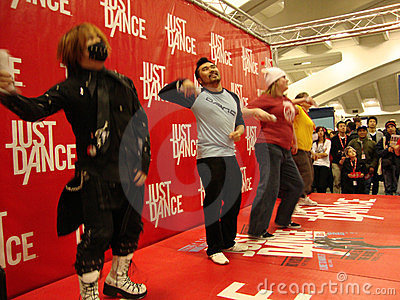People play Just Dance for the Wii on Stage Editorial Stock Photo