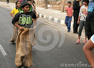 people play sack race on the road during happy roads program editorial stock image image 51331839. Black Bedroom Furniture Sets. Home Design Ideas