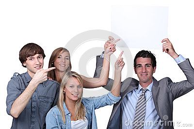 People pointing at sign