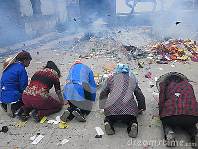 People Pray Before Burning Joss Paper in China Editorial Image