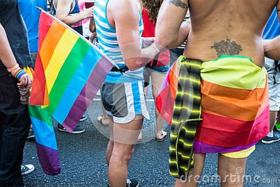 People with rainbow objects and flags Editorial Photo