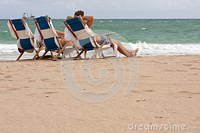 People Relax In Beach Chairs On Florida Beach Editorial Image