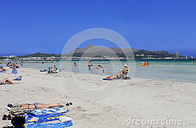 People relaxing on beach in Majorca Editorial Stock Photo