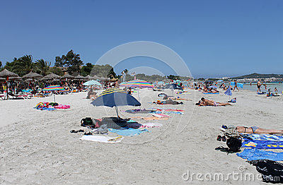 People relaxing on beach in Majorca Editorial Photography