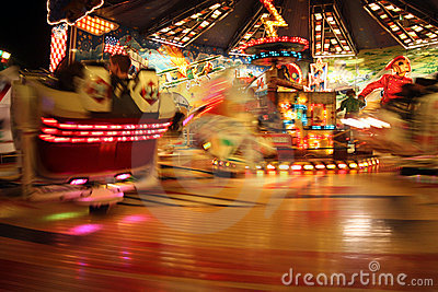 People riding carnival ride at night