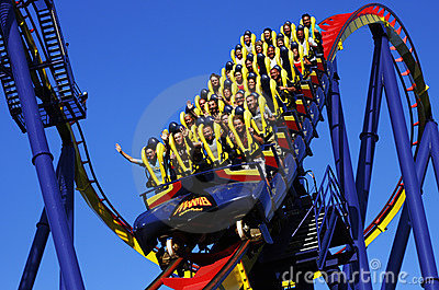 People riding roller coaster Editorial Photography
