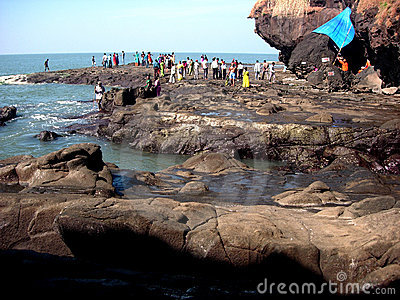 People on rocky shoreline