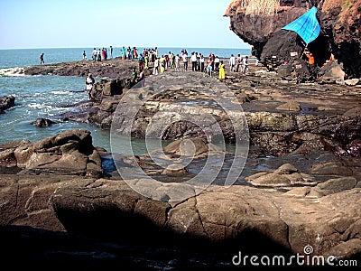 People on rocky shoreline