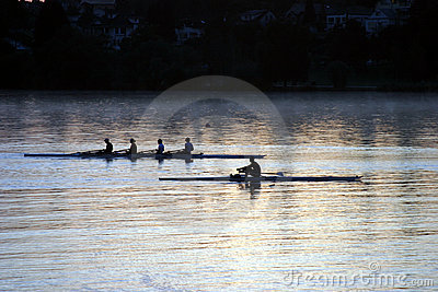 People rowing at sunrise