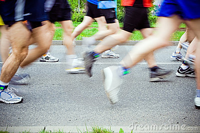 People running in city marathon, sport shoes