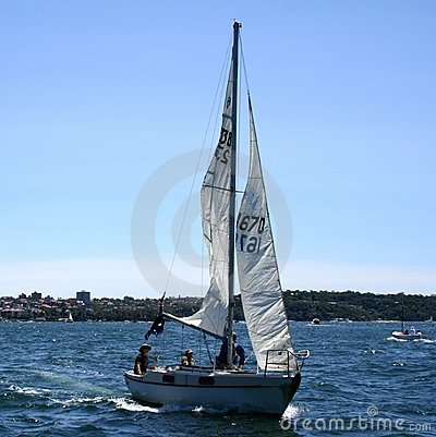 People sailing yacht in sea